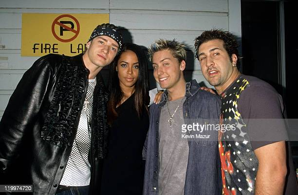 Justin Timberlake Aaliyah Lance Bass and Joey Fatone backstage at the MTV Movie Awards at Sony Studios on June 3 2000 in Culver City California