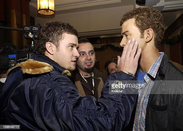 Justin Timberlake and Chris Kirkpatrick during *NSYNC Attend Unveiling of Their Wax Figures at Madame Tussaud's New York at Madame Tussaud's Wax...