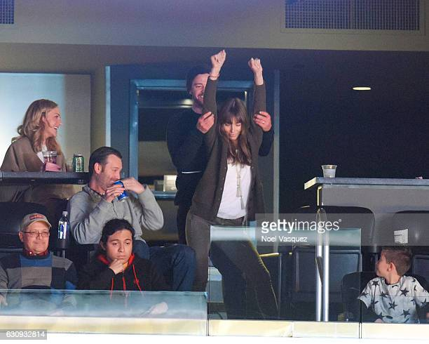 Justin Timberlake and Jessica Biel dance together at a basketball game between the Memphis Grizzlies and the Los Angeles Lakers at Staples Center on...