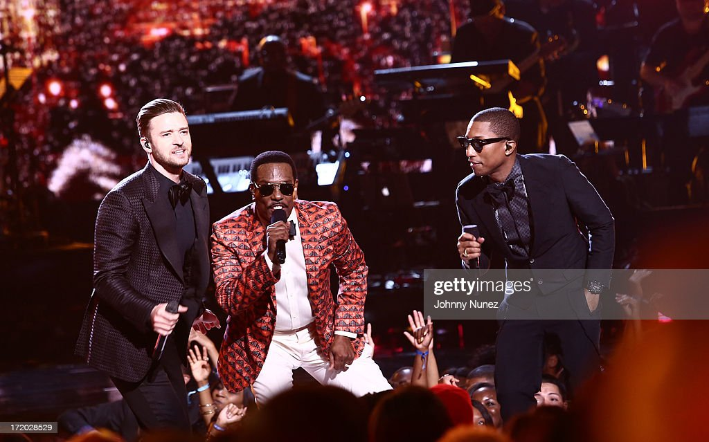 <a gi-track='captionPersonalityLinkClicked' href=/galleries/search?phrase=Justin+Timberlake&family=editorial&specificpeople=157482 ng-click='$event.stopPropagation()'>Justin Timberlake</a>, Charlie Wilson and <a gi-track='captionPersonalityLinkClicked' href=/galleries/search?phrase=Pharrell+Williams&family=editorial&specificpeople=161396 ng-click='$event.stopPropagation()'>Pharrell Williams</a> perform at the 2013 BET Awards at Nokia Plaza L.A. LIVE on June 30, 2013 in Los Angeles, California.