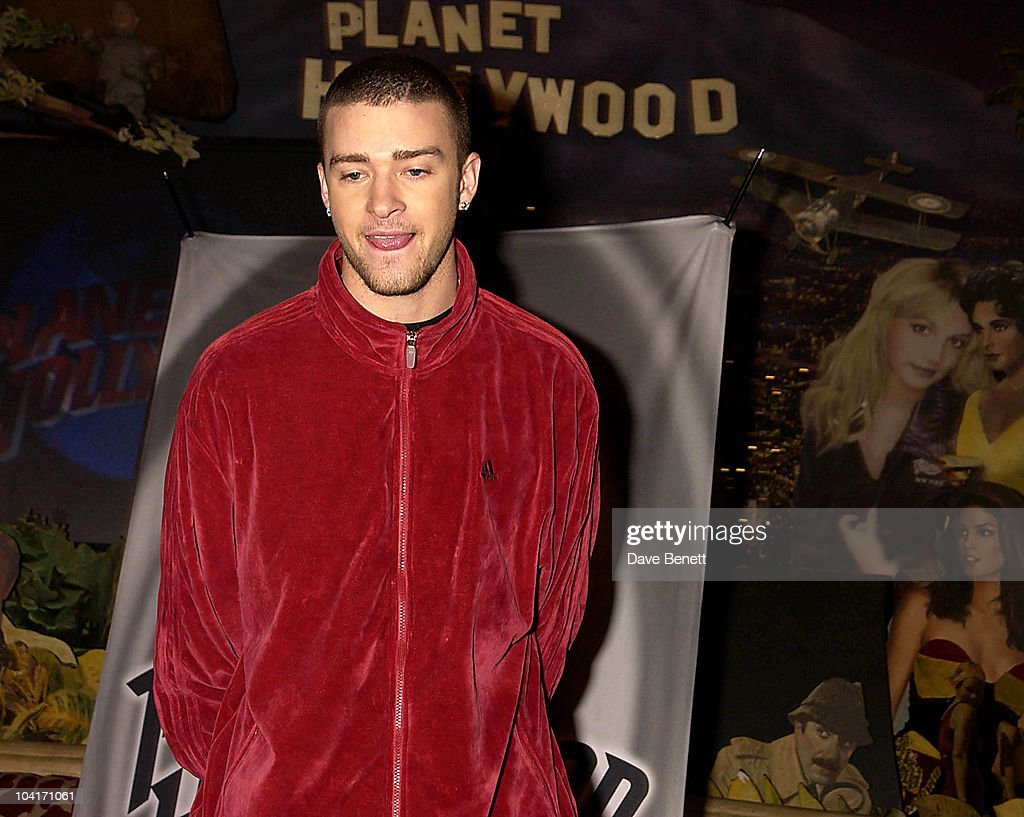 Justin Timberlake (inadvertantly Standing In Front Of His Famous Ex Girlfriend Britney Spears, Who's Picture Is On The Wall), Justin Timberlake At Planet Hollywood In London. The American Teen Star Turned Up Unexpectedely While On A Promotional Tour Of His New Single 'Cry Me A River', Lucky Planet Hollwood Customers Caught A Glimpse Of Him As He Welcomed Them, Joking Ônot To Worry, He Was'Nt About To Cook Their Burgers'