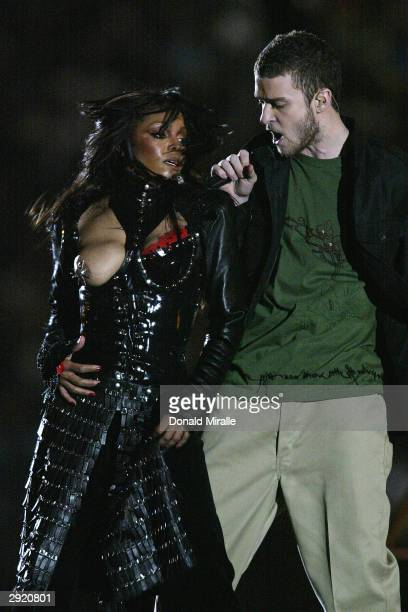 Justin Timberlake performs with Janet Jackson during the halftime show at Super Bowl XXXVIII between the New England Patriots and the Carolina...