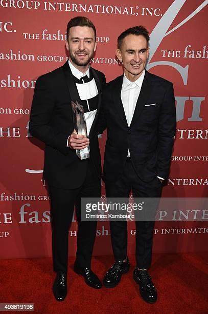 Justin Timberlake poses with his award and Fashion Designer Neil Barrett at the 2015 Fashion Group International Night Of Stars Gala at Cipriani Wall...