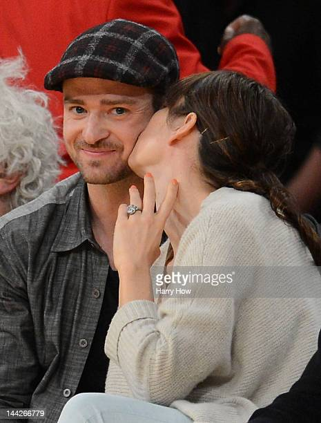 Justin Timberlake smiles as Jessica Biel gives him a kiss coutside as the Los Angeles Lakers take on the Denver Nuggets in Game Seven of the Western...