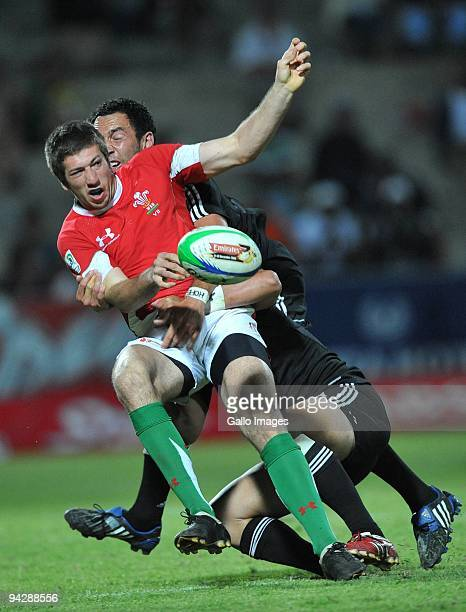 Justin Tiperic of Wales tackled by Tomasi Cama of New Zealand during the IRB Sevens Series match between New Zealand and Wales at Quteniqua Park on...