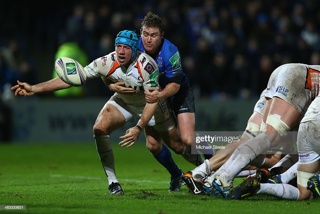 Justin Tipuric of Ospreys feeds a pass as Eoin Reddan of Leinster challenges during the Heineken Cup Pool One match between |Leinster and Ospreys at...