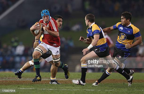 Justin Tipuric of the Lions charges upfield during the match between Combined Country and the British Irish Lions at Hunter Stadium on June 11 2013...