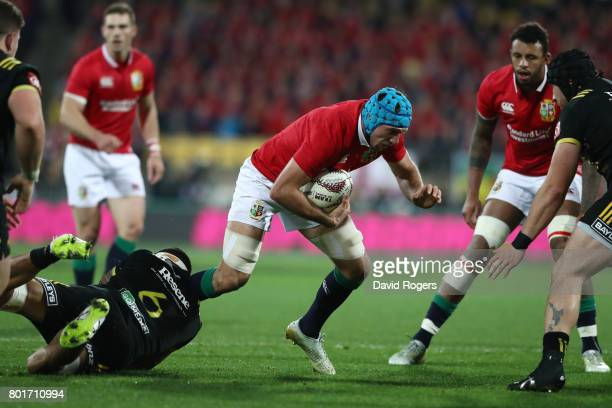Justin Tipuric of the Lions is tackled by Vaea Fifita of the Hurricanes during the 2017 British Irish Lions tour match between the Hurricanes and the...
