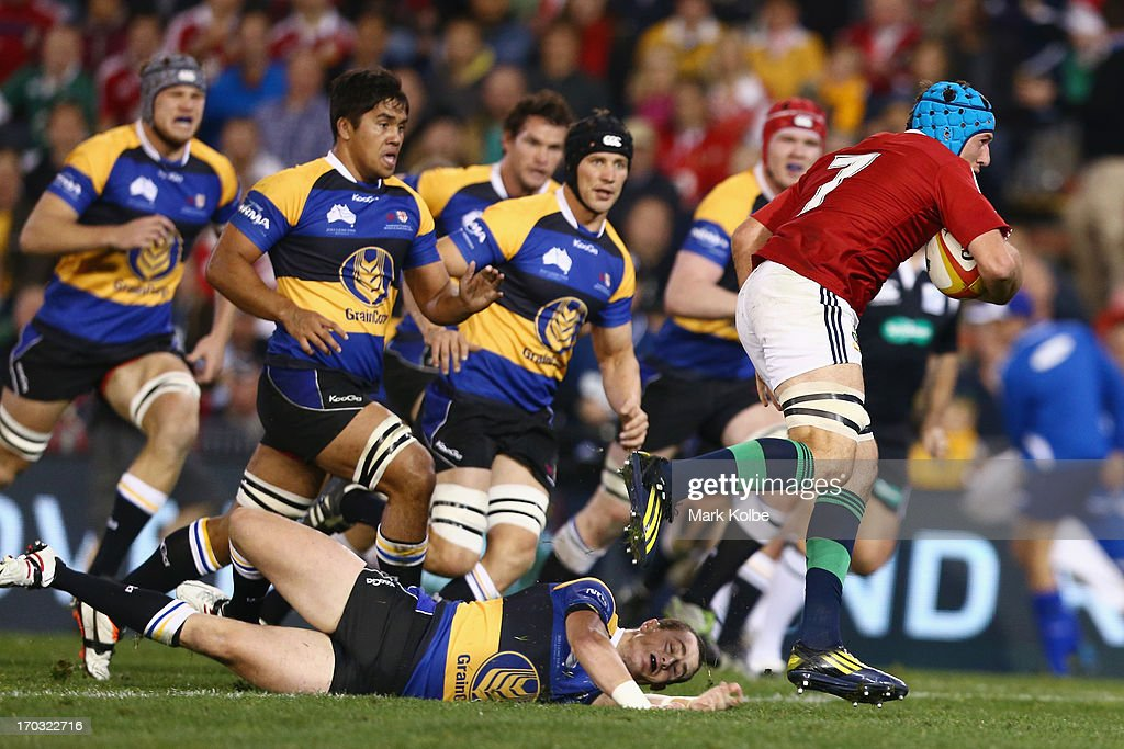 Justin Tipuric of the Lions makes a break during the match between Combined Country and the British Irish Lions at Hunter Stadium on June 11 2013 in...