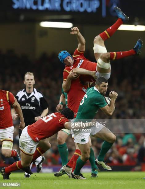 Justin Tipuric of Wales falls as Rob Kearney of Ireland breaks with the ball during the Six Nations match between Wales and Ireland at the...