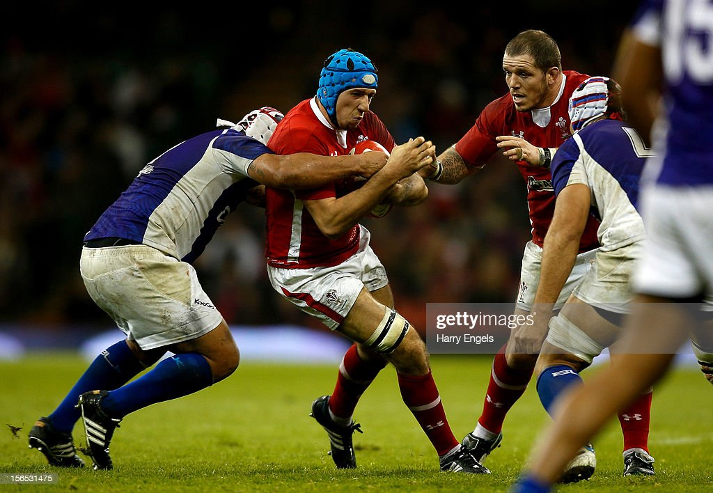 Justin Tipuric of Wales is tackled by the Samoa defence during the international match between Wales and Samoa at the Millennium Stadium on November 16, 2012 in Cardiff, Wales.