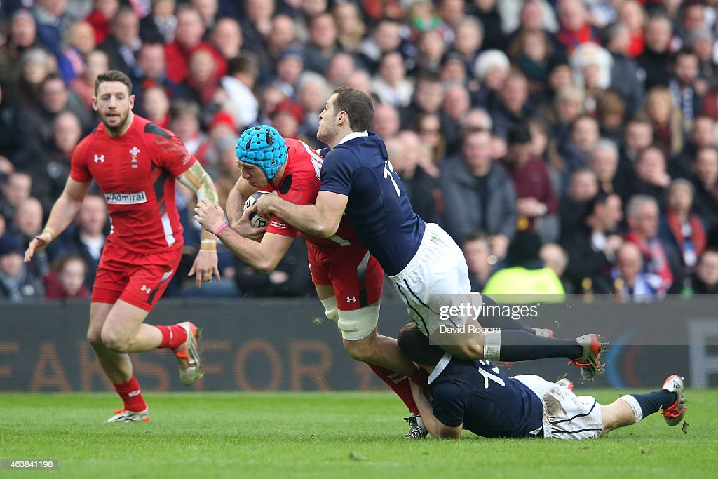 Justin Tipuric of Wales is tackled by Tim Visser of Scotland and Mark Bennett of Scotland during the RBS Six Nations match between Scotland and Wales...