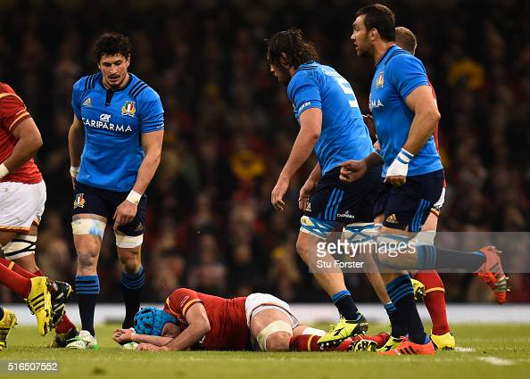 Justin Tipuric of Wales lies injured following a fall at a lineoout uring the RBS Six Nations match between Wales and Italy at the Principality...