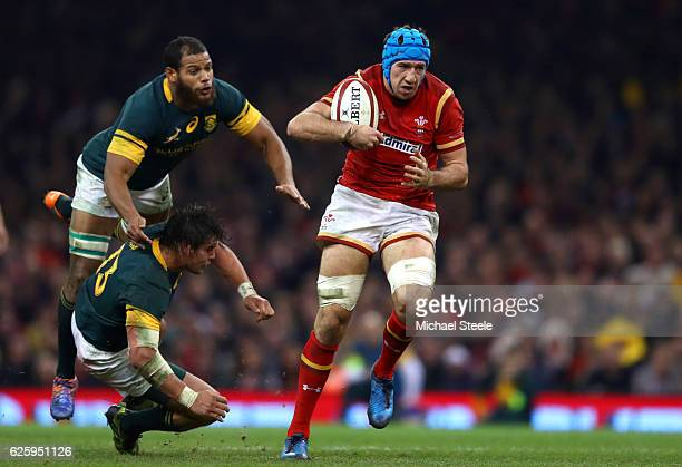 Justin Tipuric of Wales makes a break to score his team's second try during the international match between Wales and South Africa at Principality...