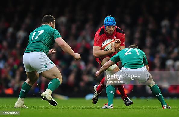 Justin Tipuric of Wales takes on Eoin Reddan of Ireland during the RBS Six Nations match between Wales and Ireland at Millennium Stadium on March 14...
