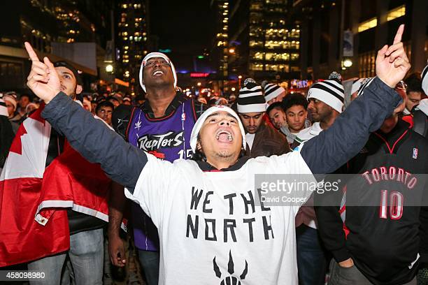 TORONTO ON OCTOBER 29 Justin Torres yells in joy as Raptors fans celebrate the first game of the season at the fans party in Maple Leaf Square...