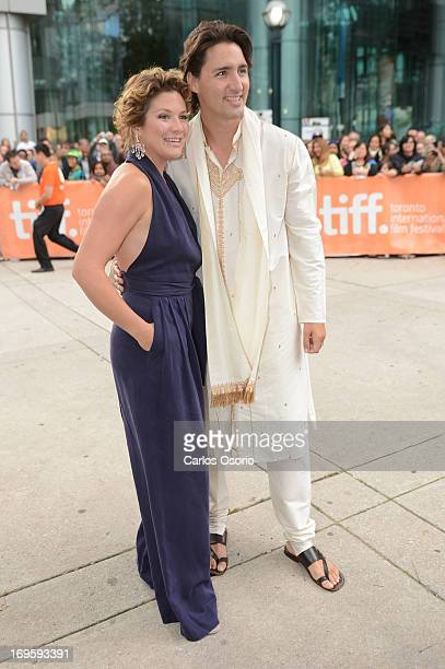 MP Justin Trudeau and his wife Sophie Gregoire pose for a photograph at Roy Thompson Hall during the TIFF premiere of the movie Midnight's Children...