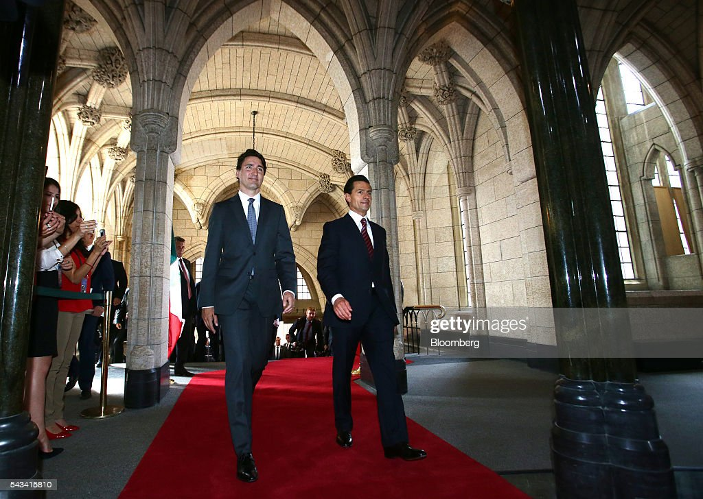 <a gi-track='captionPersonalityLinkClicked' href=/galleries/search?phrase=Justin+Trudeau&family=editorial&specificpeople=2616495 ng-click='$event.stopPropagation()'>Justin Trudeau</a>, Canada's prime minister, left, and <a gi-track='captionPersonalityLinkClicked' href=/galleries/search?phrase=Enrique+Pena+Nieto&family=editorial&specificpeople=5957985 ng-click='$event.stopPropagation()'>Enrique Pena Nieto</a>, Mexico's president, walk into the foyer of Parliament Hill ahead of the North American Leaders Summit (NALS) in Ottawa, Ontario, Canada, on Tuesday, June 28, 2016. Trudeau. Nieto, and U.S. President Barack Obama hold the so-called Three Amigos summit Wednesday in Ottawa, with fallout from the U.K.'s vote last week to leave the European Union raising pressure to show confidence in their own alliance. The countries will vow to produce more clean power and cut methane emissions while strengthening economic ties. Photographer: Cole Burston/Bloomberg via Getty Images