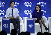 Justin Trudeau Canada's prime minister left and Sheryl Sandberg chief operating officer of Facebook Inc take part in a panel session during the World...