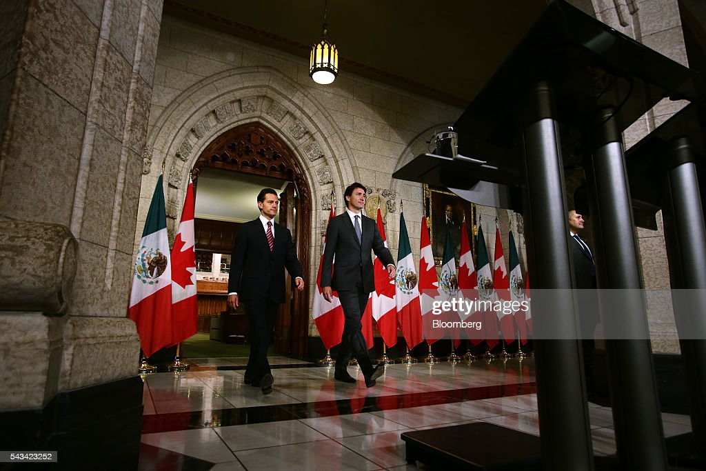 Justin Trudeau, Canada's prime minister, right, and Enrique Pena Nieto, Mexico's president, arrive to a joint press conference at Parliament Hill ahead of the North American Leaders Summit (NALS) in Ottawa, Ontario, Canada, on Tuesday, June 28, 2016. Trudeau, Nieto, and U.S. President Barack Obama hold the so-called Three Amigos summit Wednesday in Ottawa, with fallout from the U.K.'s vote last week to leave the European Union raising pressure to show confidence in their own alliance. The countries will vow to produce more clean power and cut methane emissions while strengthening economic ties. Photographer: Cole Burston/Bloomberg via Getty Images