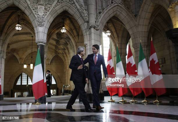 Justin Trudeau Canada's prime minister right and Paolo Gentiloni Italy's prime minister arrive for a working meeting on Parliament Hill in Ottawa...