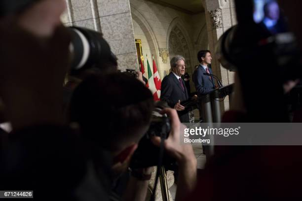 Justin Trudeau Canada's prime minister right listens as Paolo Gentiloni Italy's prime minister speaks during a joint press conference on Parliament...