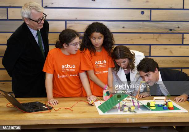 Justin Trudeau Canada's prime minister right views 3D city models built by children during an event in Toronto Ontario Canada on Tuesday Oct 17 2017...
