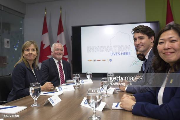 Justin Trudeau Canada's prime minister second right and Mary Barra chief executive officer of General Motors Corp left sit for photographs during a...