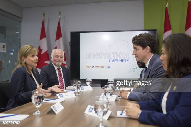 Justin Trudeau Canada's prime minister second right listens as Mary Barra chief executive officer of General Motors Corp left speaks during a meeting...