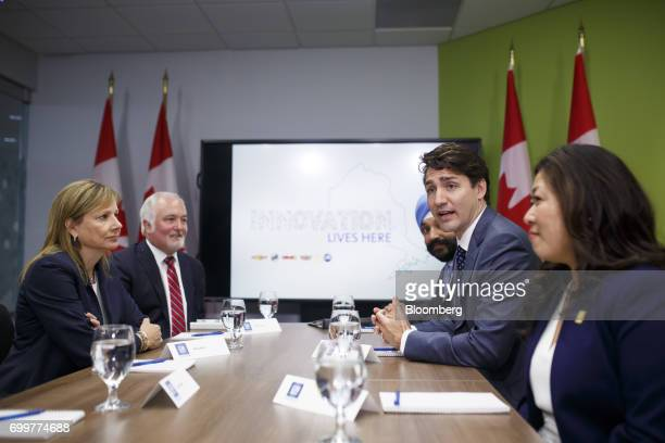 Justin Trudeau Canada's prime minister second right speaks as Mary Barra chief executive officer of General Motors Corp left listens during a meeting...