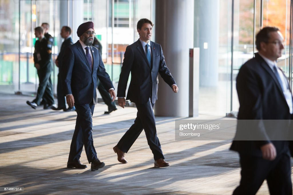 Justin Trudeau, Canada's prime minister, walks with Harjit Sajjan, Canada's defense minister, left, during the 2017 UN Peacekeeping Defence Ministerial conference in Vancouver, British Columbia, Canada, on Wednesday, Nov. 15, 2017. Over 500 delegates from more than 70 countries and international organizations will gather at the upcoming Defence Ministerial to discuss improvements to UN peacekeeping operations and focus on securing new pledges from Member States. Photographer: Ben Nelms/Bloomberg via Getty Images