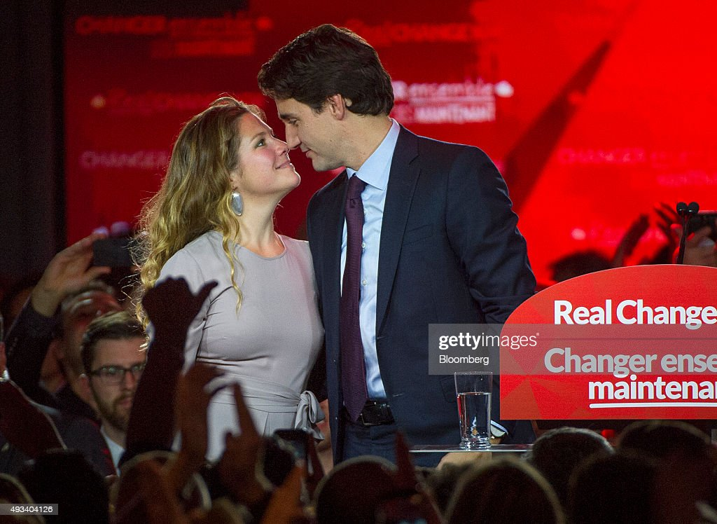 Justin Trudeau, Canada's prime minister-elect and leader of the Liberal Party of Canada, shares a moment with his wife Sophie Gregoire-Trudeau after being elected prime minister on election night Montreal, Quebec, Canada, on Tuesday, Oct. 20, 2015. Trudeau's Liberal Party swept into office with a surprise majority, ousting Prime Minister Stephen Harper and capping the biggest comeback election victory in Canadian history. Photographer: Kevin Van Paassen/Bloomerg