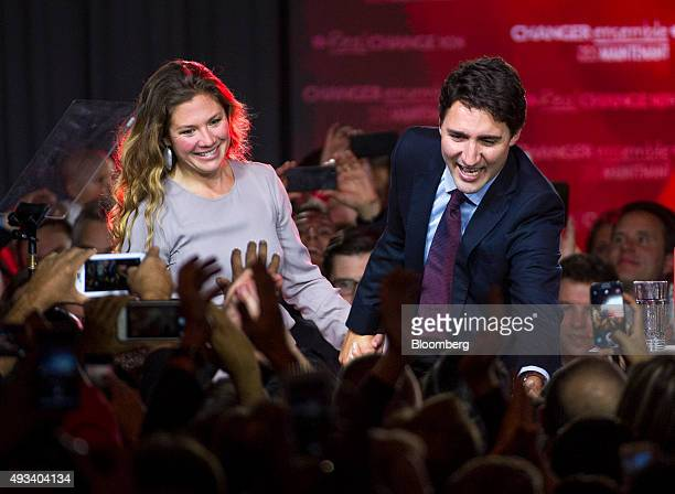 Justin Trudeau Canada's prime ministerelect and leader of the Liberal Party of Canada and his wife Sophie GregoireTrudeau greet supporters on...
