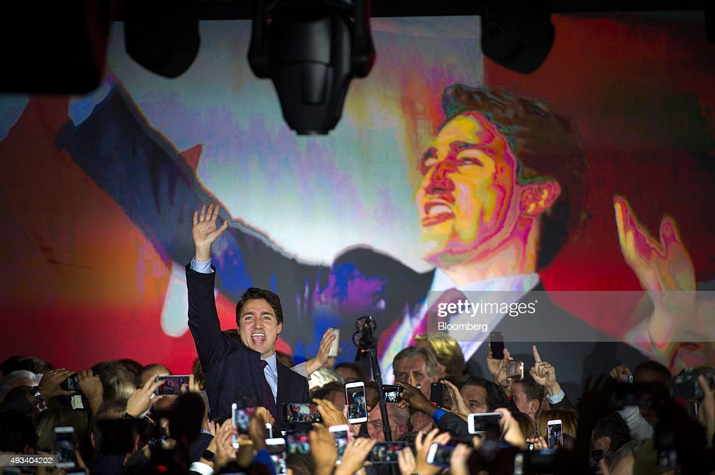 Justin Trudeau, Canada's prime minister-elect and leader of the Liberal Party of Canada, waves to supporters on election night in Montreal, Quebec, Canada, on Tuesday, Oct. 20, 2015. Trudeau's Liberal Party swept into office with a surprise majority, ousting Prime Minister Stephen Harper and capping the biggest comeback election victory in Canadian history. Photographer: Kevin Van Paassen/Bloomerg
