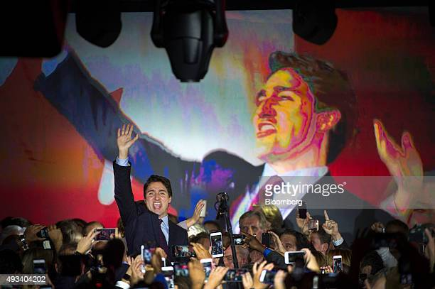 Justin Trudeau Canada's prime ministerelect and leader of the Liberal Party of Canada waves to supporters on election night in Montreal Quebec Canada...