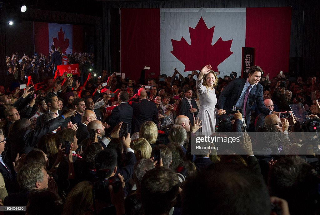 Justin Trudeau, Canada's prime minister-elect and leader of the Liberal Party of Canada, and his wife Sophie Gregoire-Trudeau greet supporters on election night in Montreal, Quebec, Canada, on Tuesday, Oct. 20, 2015. Trudeau's Liberal Party swept into office with a surprise majority, ousting Prime Minister Stephen Harper and capping the biggest comeback election victory in Canadian history. Photographer: Kevin Van Paassen/Bloomerg
