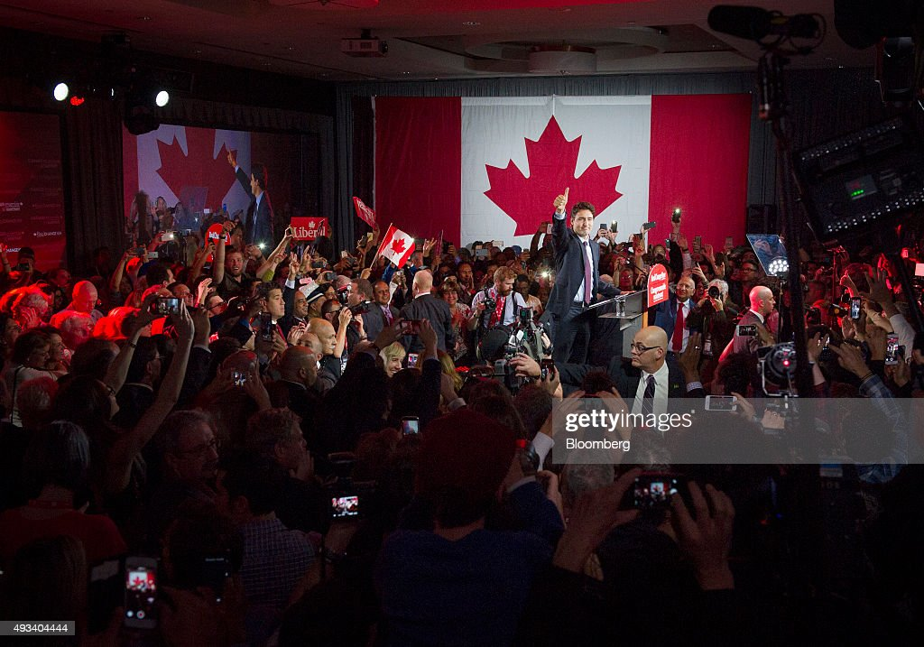 Justin Trudeau, Canada's prime minister-elect and leader of the Liberal Party of Canada, gestures to supporters on election night in Montreal, Quebec, Canada, on Tuesday, Oct. 20, 2015. Trudeau's Liberal Party swept into office with a surprise majority, ousting Prime Minister Stephen Harper and capping the biggest comeback election victory in Canadian history. Photographer: Kevin Van Paassen/Bloomerg
