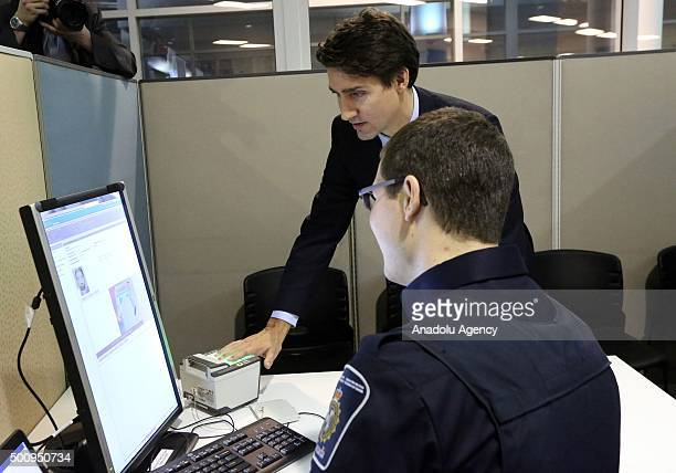 Justin Trudeau Prime Minister of Canada is given a demonstration of a biometric machine by Border Services Officer Steenbakkers prior to the arrival...