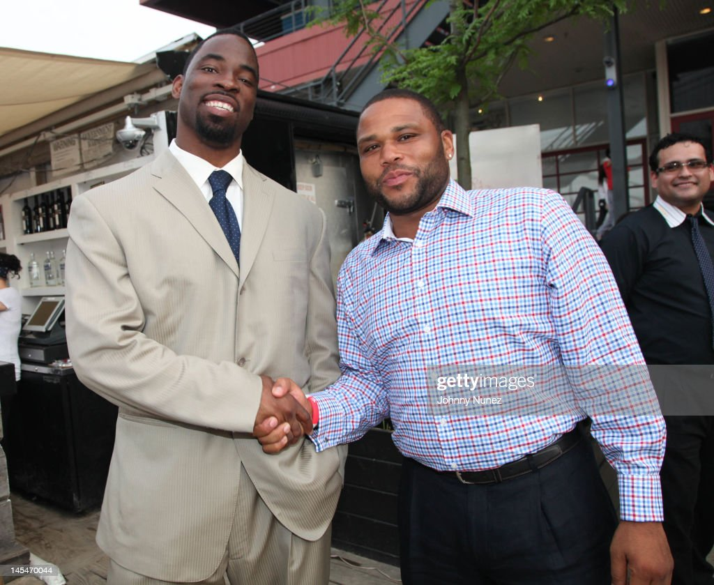 Justin Tuck and Anthony Anderson attend the NY Giants Justin Tuck VIP charity reception at the Beekman Beer Garden on May 30 2012 in New York City