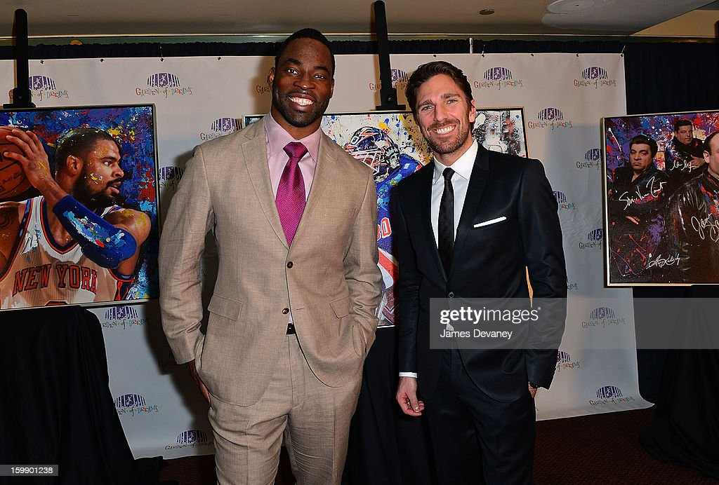 Justin Tuck and Henrik Lundqvist attend the Garden of Dreams Foundation Gallery Collection launch event at Madison Square Garden on January 22 2013...