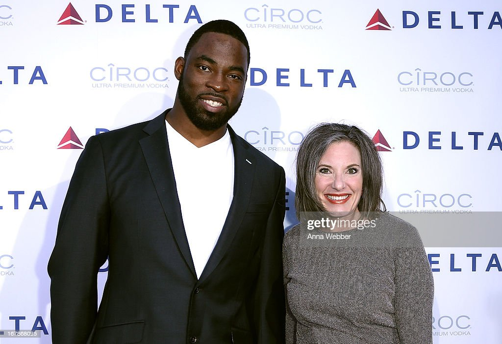 <a gi-track='captionPersonalityLinkClicked' href=/galleries/search?phrase=Justin+Tuck&family=editorial&specificpeople=748769 ng-click='$event.stopPropagation()'>Justin Tuck</a> and Senior Vice President of Delta Airlines Gail Grimmett attend as Delta Air Lines celebrate the opening night of T4X, a pop up experience showcasing distinctive features of the airline's newly transformed international hub at JFK's Terminal 4 on May 1, 2013 in New York City.