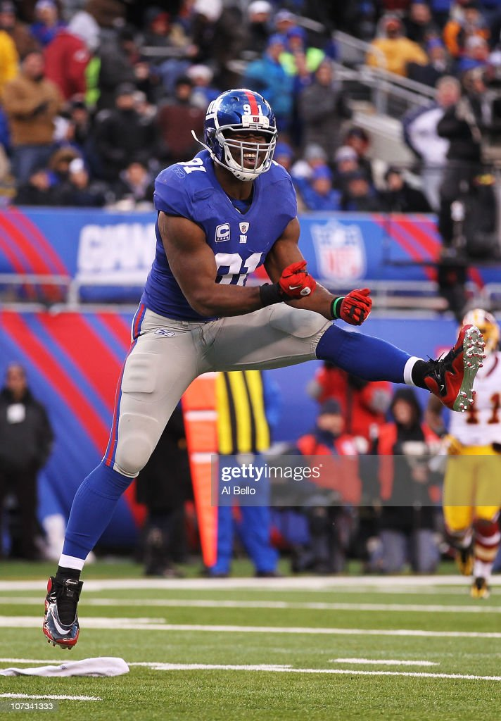 Justin Tuck of the New York Giants celebrates after sacking Donovan McNabb of the Washington Redskins who fumbled and loset the ball during their...