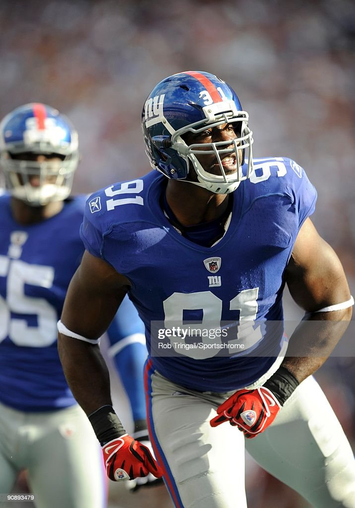Justin Tuck of the New York Giants reacts against the Washington Redskins during their game on September 13 2009 at Giants Stadium in East Rutherford...