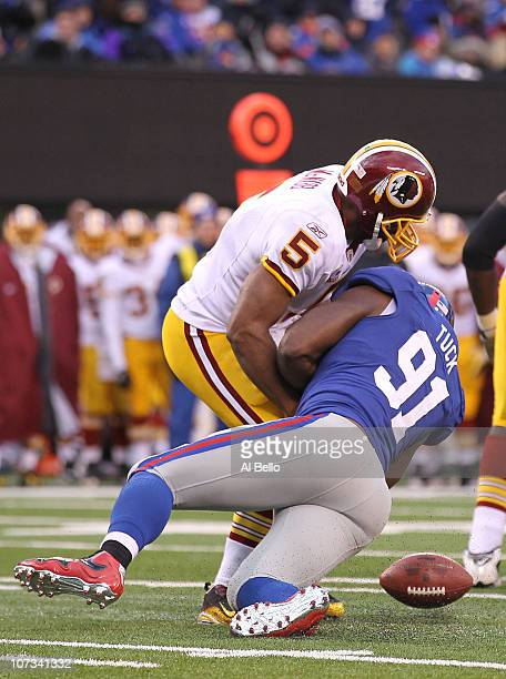 Justin Tuck of the New York Giants sacks Donovan McNabb of the Washington Redskins who fumbles and loses the ball during their game on December 5...