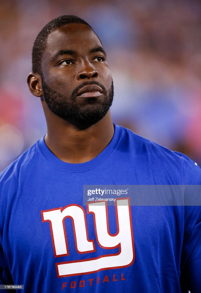 Justin Tuck #91 of the New York Giants walks on the sidelines during their preseason game against the Indianapolis Colts at MetLife Stadium on August 18, 2013 in East Rutherford, New Jersey.
