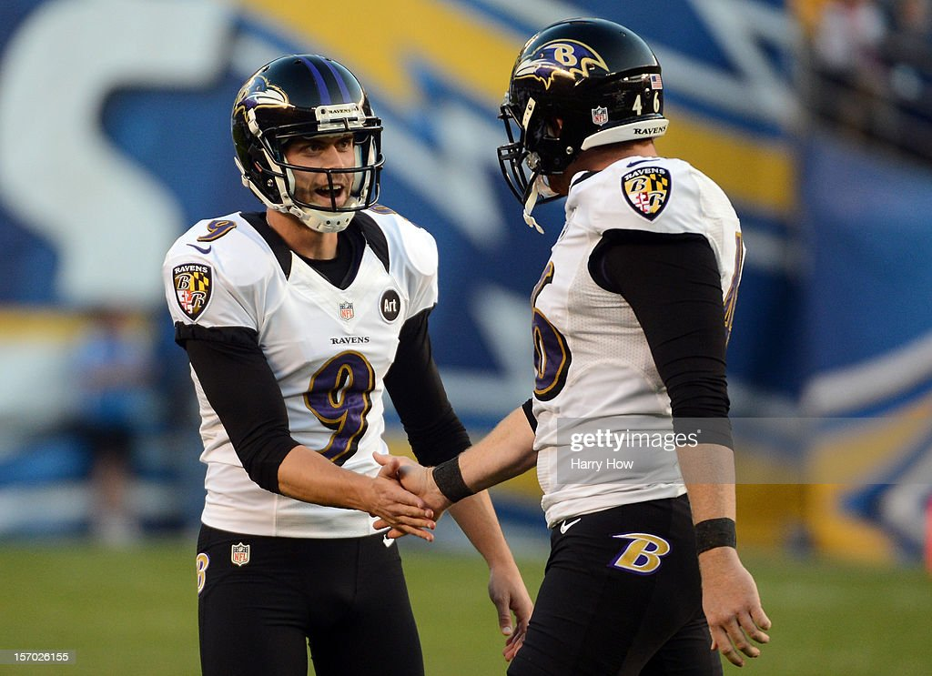 Justin Tucker of the Baltimore Ravens celebrates a field goal with Morgan Cox during a 1613 win over the San Diego Chargers at Qualcomm Stadium on...