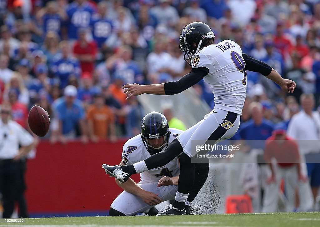 Justin Tucker #9 of the Baltimore Ravens kicks a field goal as <a gi-track='captionPersonalityLinkClicked' href=/galleries/search?phrase=Sam+Koch&family=editorial&specificpeople=2106602 ng-click='$event.stopPropagation()'>Sam Koch</a> #4 holds during NFL game action against the Buffalo Bills at Ralph Wilson Stadium on September 29, 2013 in Orchard Park, New York.
