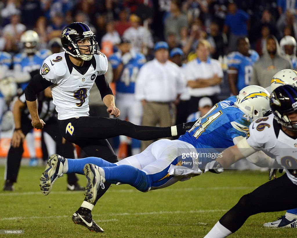Justin Tucker #9 of the Baltimore Ravens kicks a game winning field goal by Corey Lynch #41 of the San Diego Chargers for a 16-13 win at Qualcomm Stadium on November 25, 2012 in San Diego, California.