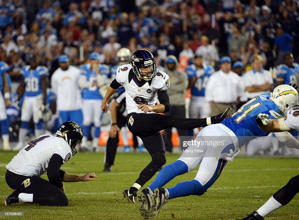 Justin Tucker #9 of the Baltimore Ravens kicks a game winning field goal by Corey Lynch #41 of the San Diego Chargers for a 16-13 win in overtime at Qualcomm Stadium on November 25, 2012 in San Diego, California.