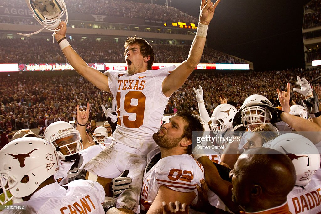 Justin Tucker #19 of the Texas Longhorns celebrates with teammates after kicking the winning field goal as time expired in the second half of a game against the Texas A&M Aggies at Kyle Field on November 24, 2011 in College Station, Texas. Texas won the game, 27-25.